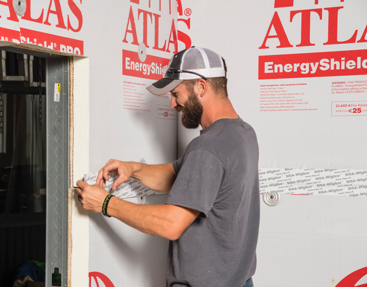Rushton Sheet Metal Employee installing Atlas products during mock-up wall training.