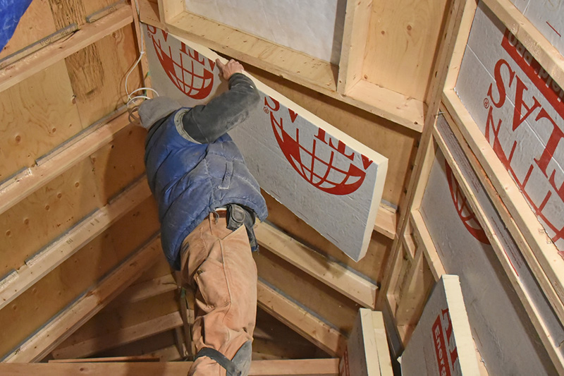 EnergyShield polyiso insulation being installed in the Tiny Home.